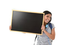 Hispanic woman or female student holding blank blackboard with copy space for adding message. Young beautiful hispanic woman or female student holding blank Royalty Free Stock Photos