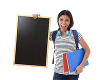 Hispanic woman or female student holding blank blackboard with copy space for adding message Royalty Free Stock Photo