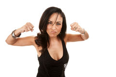 Hispanic woman flexing and showing her fists Stock Images