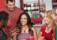 Hispanic Woman with Friends Stock Photos