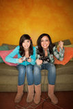 Hispanic Woman and Girl Playing Video game Royalty Free Stock Images