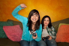 Hispanic Woman and Girl Playing Video Game Royalty Free Stock Image