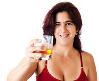 Hispanic woman with a glass of whisky Royalty Free Stock Photography