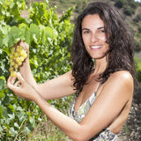 Hispanic woman with grapes Stock Image