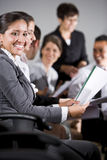 Hispanic woman in group presentation Stock Photography