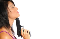 Hispanic woman with a gun. Attractive hispanic woman posing on a white background holding a handgun Stock Photography
