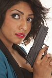 Hispanic woman gun close Stock Images
