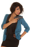 Hispanic woman gun point back Stock Photo