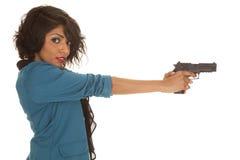 Hispanic woman gun side look Stock Photos