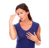 Hispanic woman with hand on head and closed eyes Royalty Free Stock Images