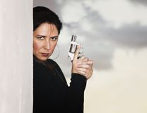 Hispanic Woman with Handgun Royalty Free Stock Image