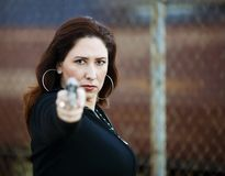 Hispanic Woman with Handgun Royalty Free Stock Photo
