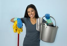Hispanic woman happy proud as home or hotel maid cleaning and ho. Young attractive hispanic woman happy proud as home or hotel maid cleaning and housekeeping stock photography