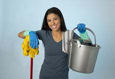 Hispanic woman happy proud as home or hotel maid cleaning and housekeeping holding mop and washing bucket smiling. Young attractive hispanic woman happy proud as Royalty Free Stock Image