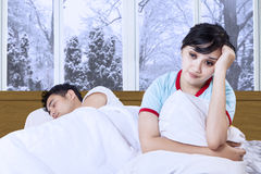 Hispanic woman having insomnia on bed Stock Image