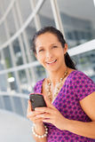 Hispanic woman holding cell phone Royalty Free Stock Photography