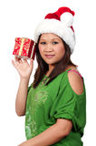 Hispanic Woman Holding a Christmas Ornament Royalty Free Stock Photo