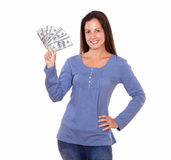 Hispanic woman holding dollars while standing Royalty Free Stock Photo