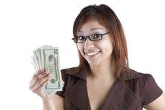Hispanic Woman Holding Money. A happy latino woman holding american money stock image