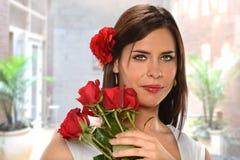 Hispanic Woman Holding Red Roses Stock Photo