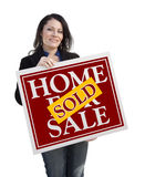 Hispanic Woman Holding Sold Home For Sale Sign on White Royalty Free Stock Image