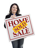 Hispanic Woman Holding Sold Home For Sale Sign on White Royalty Free Stock Images