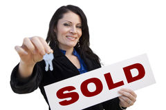 Hispanic Woman Holding Sold Sign and Keys On White. Smiling Hispanic Woman Holding Sold Real Estate Sign and Keys Isolated On White Stock Images