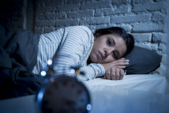 Hispanic woman at home bedroom lying in bed late at night trying to sleep suffering insomnia Stock Photo