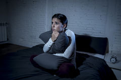 Hispanic woman at home bedroom lying in bed late at night trying to sleep suffering insomnia Stock Image