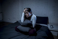 Hispanic woman at home bedroom lying in bed late at night trying to sleep suffering insomnia Royalty Free Stock Image