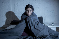 Hispanic woman at home bedroom lying in bed late at night trying to sleep suffering insomnia. Young beautiful hispanic woman at home bedroom lying in bed late at Royalty Free Stock Photography