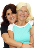 Hispanic woman hugging her mother isolated on whit Stock Photography