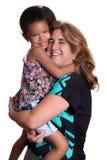 Hispanic woman hugging a mutiracial little girl Royalty Free Stock Images