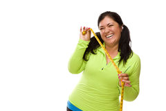 Hispanic Woman In Workout Clothes And Tape Measure Royalty Free Stock Photos