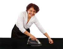 Hispanic Woman Ironing Sheet Royalty Free Stock Photos