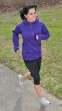 Hispanic woman jogging Royalty Free Stock Images