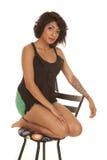 Hispanic woman kneel chair red lips Stock Photography