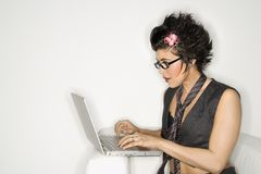 Hispanic woman on laptop. Royalty Free Stock Images