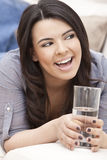Hispanic Woman Laughing Drinking Glass of Water Stock Photo