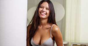 Hispanic woman in lingerie smiling at camera Royalty Free Stock Image