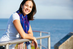 Hispanic Woman Looking Over Railing At Sea Royalty Free Stock Photography