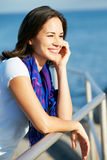 Hispanic Woman Looking Over Railing At Sea Stock Photos