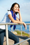 Hispanic Woman Looking Over Railing At Sea Royalty Free Stock Image