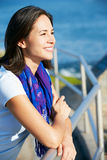 Hispanic Woman Looking Over Railing At Sea Stock Image
