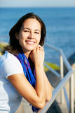 Hispanic Woman Looking Over Railing At Sea Royalty Free Stock Photo