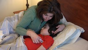 Hispanic woman looking after sick son
