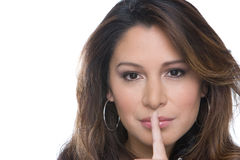 Hispanic woman making hand gesture isolated on white. Royalty Free Stock Images