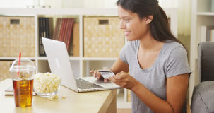 Hispanic woman making a purchase online Royalty Free Stock Images