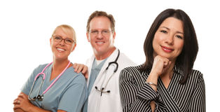 Hispanic Woman with Male Doctor and Nurse Stock Photos