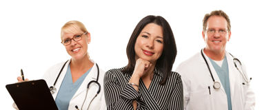 Hispanic Woman with Male Doctor and Nurse royalty free stock image